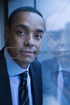 Portrait of Businessman and His Reflection