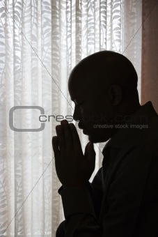 Man With Hands in Prayer