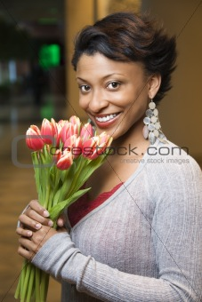 Portrait of Smiling Woman With Tulips