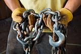 Gloved Hands Holding a Chain