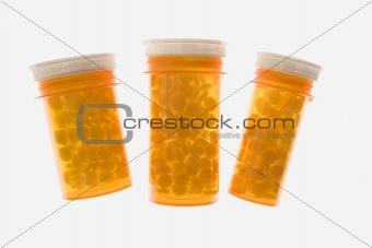Three Yellow Plastic Medicine Bottles. Isolated