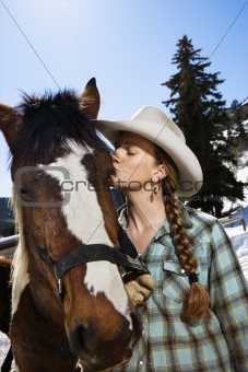 Attractive Young Woman Kissing Horse