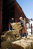 Attractive Couple Moving Hay Bales