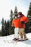 Couple on Skis on Mountain Slope