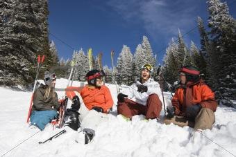 Skiers Sitting in Snow Talking