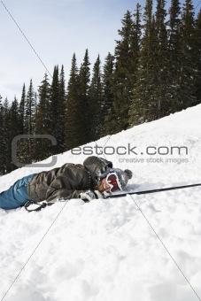 Skier Lying in Snow