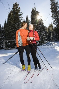 Cross Country Snow Skiiers Smiling at Each Other