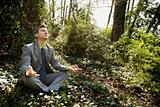 Young Businessman Sitting in Meditation