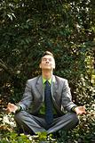 Businessman in Meditation Outside