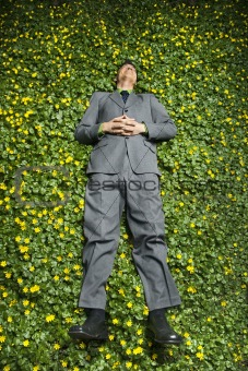 Young Businessman Lying in Flower Patch