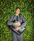 Businessman Lying in Flower Patch