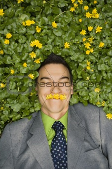 Smiling Businessman in Flower Patch