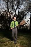 Young Businessman Holding Shovel