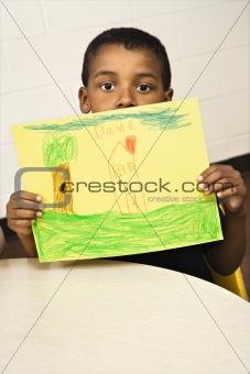 Boy Holding Drawing