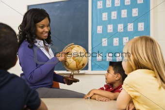 Teacher Holding Globe