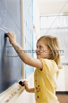 Girl Writing on Blackboard