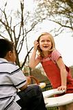 Young Girl and Boy Playing on Playground