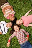 Children Lying in Clover With Heads Together