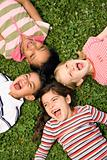 Children Lying in Clover Screaming With Heads Together