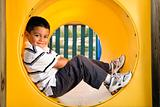 Young Boy Lying in Crawl Tube