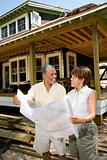 Couple Holding Building Plans
