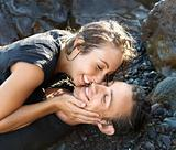 Attractive Young Couple on Rocks Smiling