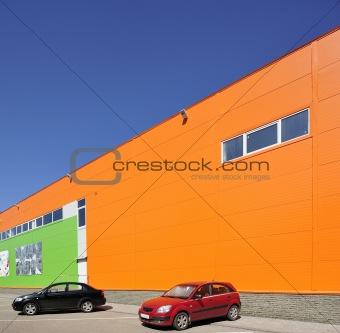 cars and wall of a hangar