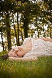 woman in green grass relaxing