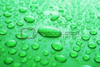 Green water drops background