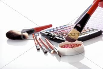 cosmetic brushes  brush , eye shadows and rouge  on the white ba