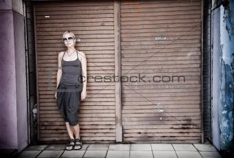 Beauty woman against wooden door