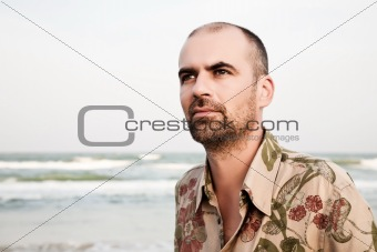 Serious man on the beachfront