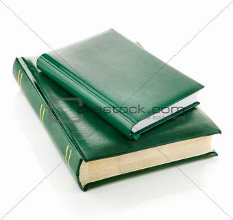 green books in the leather binding