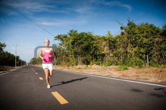 Beautiful young woman running