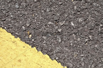 Asphalt texture with yellow corner