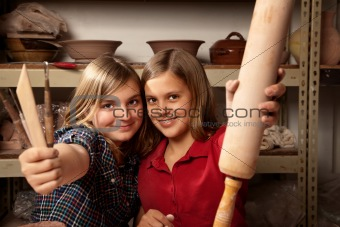 Cute young girls in a clay studio