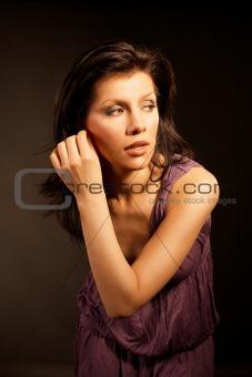 Beautiful woman wearing lilac dress
