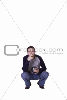 Crouched Mediterranean Man Smoking and Drinking Coffee