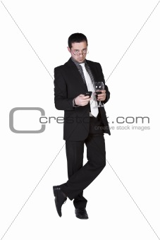 Businessman celebrating with a glass of drink and a smoke