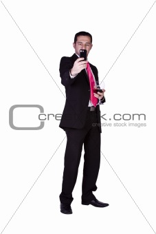 Businessman  with a glass of drink taking a picture