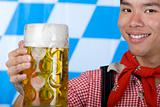 Smiling young man holding Oktoberfest beer stein (Mass)