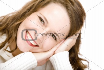 Portrait of smiling attractive woman with cheek on hands