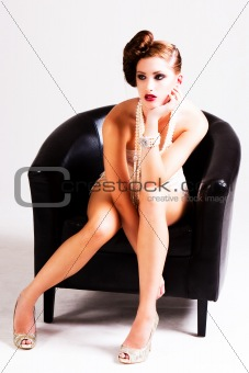 Attractive Young Woman Sitting in a Chair