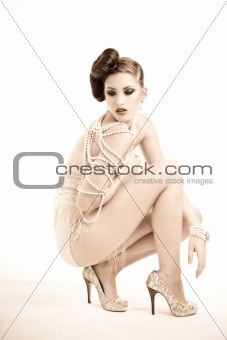 Attractive Young Woman Wearing Pearls and Nightwear. Isolated