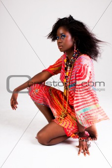 Attractive Young Woman Squating with Arm on Knee