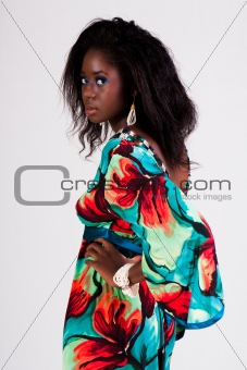 Attractive Young Woman in a Colorful Dress