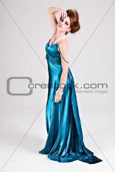 Attractive Young Woman Wearing a Blue Satin Dress