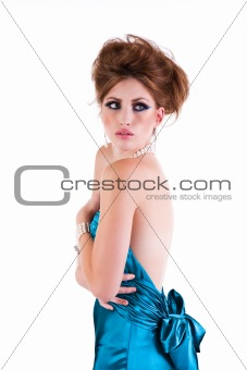 Attractive Young Woman Wearing a Blue Satin Dress. Isolated