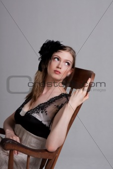 Attractive Young Woman Sitting in a Rocking Chair