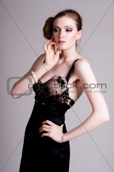 Attractive Young Woman Wearing a Black Gown